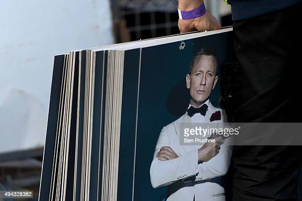 Workmen line the red carpet with film posters ahead of the Royal Film Performance of Spectre at Royal Albert Hall on October 26 2015 in London...