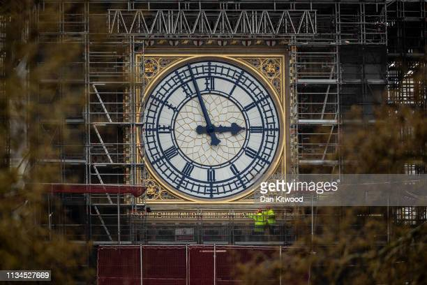 Workmen look at the clockface on the Queen Elizabeth Tower, commonly referred to as Big Ben on April 2, 2019 in London, England. The current deadline...