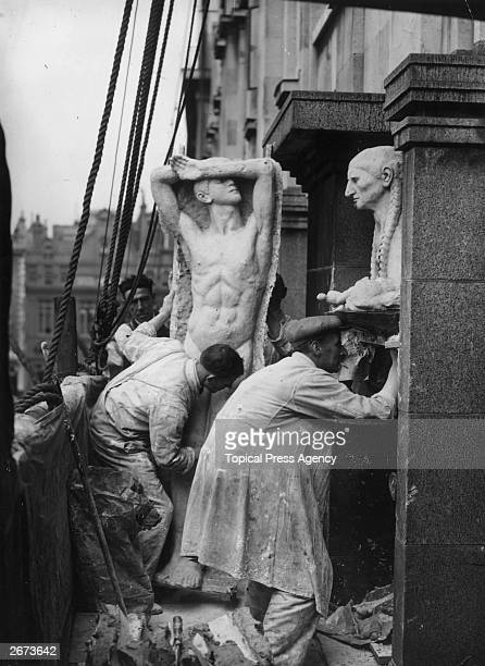 Workmen making plaster casts of Epstein statues on Rhodesia House before they were to be removed for safety reasons