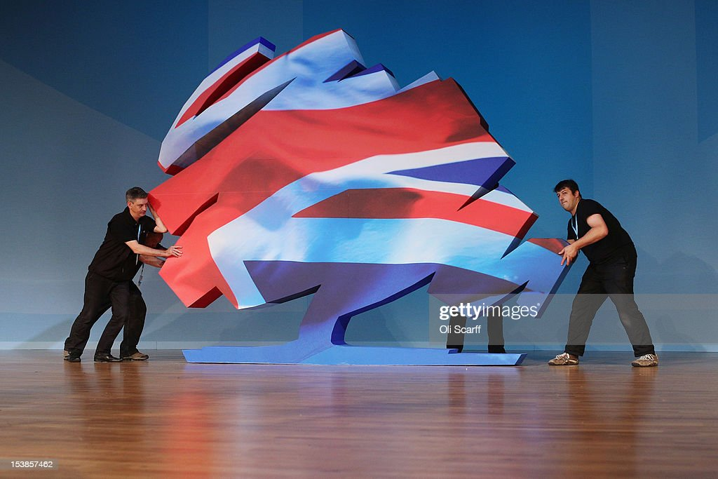 Workmen Manoeuvre A Large Model Of The Conservative Party Symbol On
