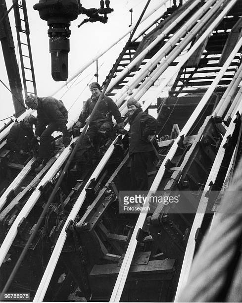 Workmen on a bridge construction site New York early 20th century