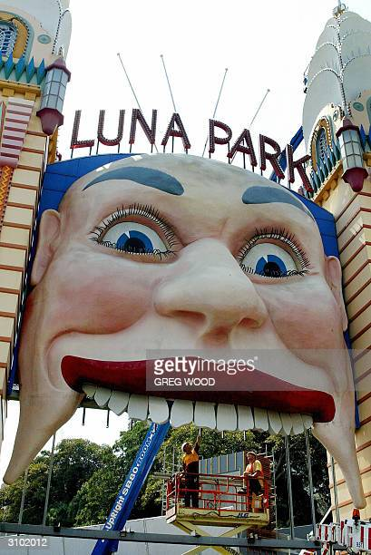 Workmen prepare to clean the famous face of Sydney's Luna Park 17 March 2004 in preparation for its official reopening on 02 April after a...