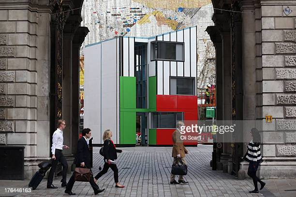Workmen put the finishing touches to a threestorey Homeshell installation in the courtyard of Burlington Gardens at the Royal Academy of Arts on...