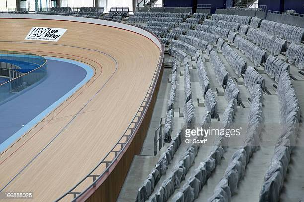 Workmen redevelop the velodrome which was used in the London 2012 Olympic Games prior to the opening of a portion of the park to the general public...