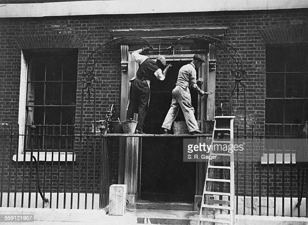 Workmen removing paint to reveal the stonework around the door of the British Prime Minister's residence at 10 Downing Street, London, 12th September...