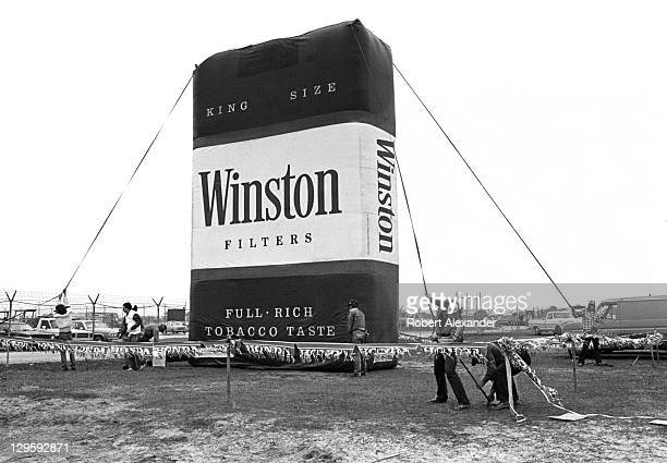 Workmen set up a huge inflatable Winston cigarette pack in the infield at the Daytona International Speedway prior to the start of the 1980 Daytona...