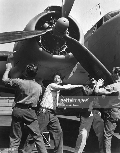 Workmen spin and test the propellers on a finished Lockheed PV1 Ventura aircraft manufactured at the Vega aircraft plant Burbank CA August 1943 US...