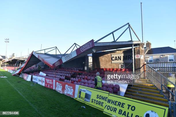 TOPSHOT Workmen survey the damage to the roof of Turners Cross stadium home to the Munster Football Association and League of Ireland side Cork City...