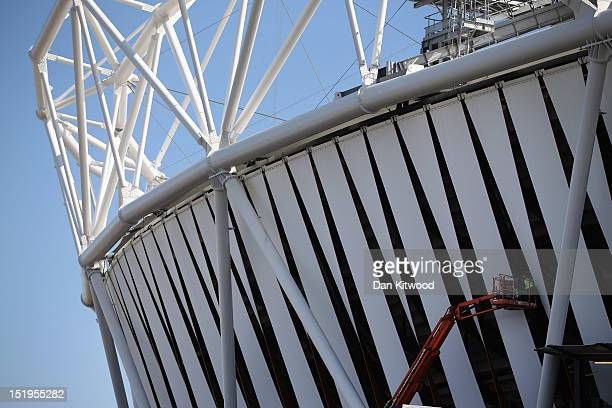 Workmen use a crane to reach the top of the Olympic Stadium in Stratford on September 13 2012 in London England The transformation of much of the...