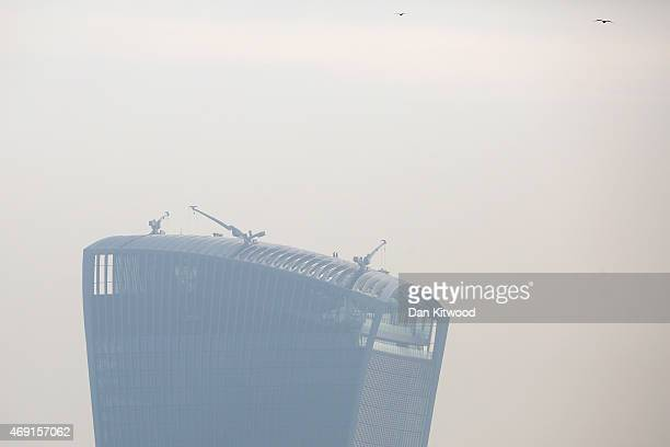 Workmen walk on top of the Walkie Talkie building in heavy smog on April 10 2015 in London England Air pollution and smog has blanketed much of...