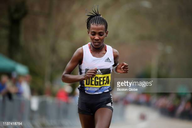 Worknesh Degefa leads the elite women runners on Heartbreak Hill during the 123rd Boston Marathon in Newton MA on April 15 2019