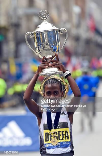 Worknesh Degefa of Ethiopia celebrates winning the women's race during the 123rd Boston Marathon in Boston Massachusetts on April 15 2019