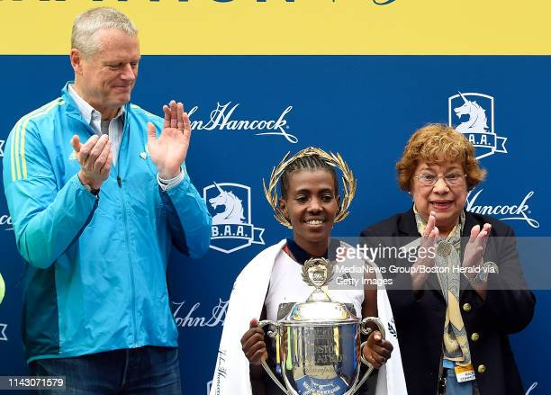 Worknesh Degefa of Ethiopia is congratulated after winning the women's race during the 123rd Boston Marathon in Boston Massachusetts on April 15 2019