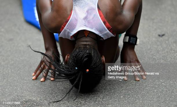 Worknesh Degefa of Ethiopia kisses the ground after winning the women's race during the 123rd Boston Marathon in Boston Massachusetts on April 15 2019
