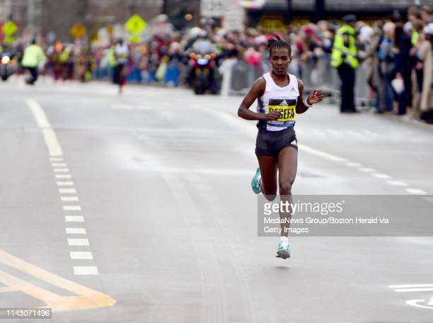 Worknesh Degefa takes the early lead in the Women's Elite race during 123rd running of the Boston Marathon