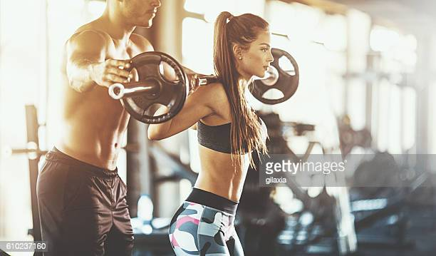workout assistance. - waist up stock pictures, royalty-free photos & images