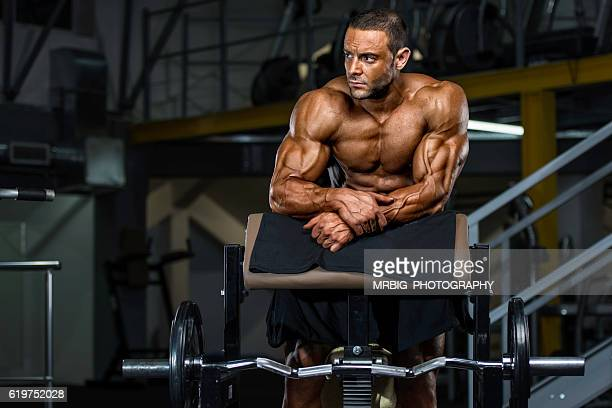 workout at the gym - handsome bodybuilders stock photos and pictures