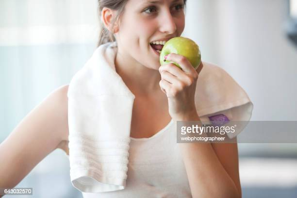 workout break - apple fruit stock photos and pictures