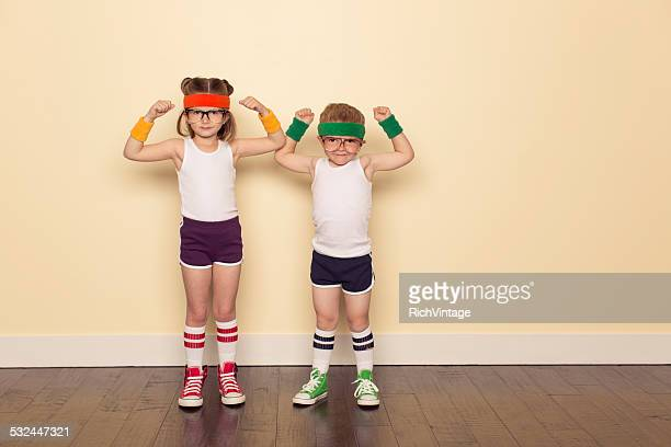 workout buddies flexing muscles - sportkleding stock pictures, royalty-free photos & images