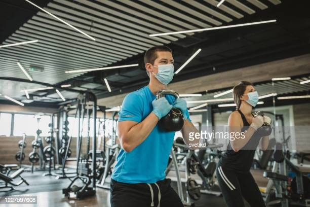 workout in gym after pandemic - gym stock pictures, royalty-free photos & images