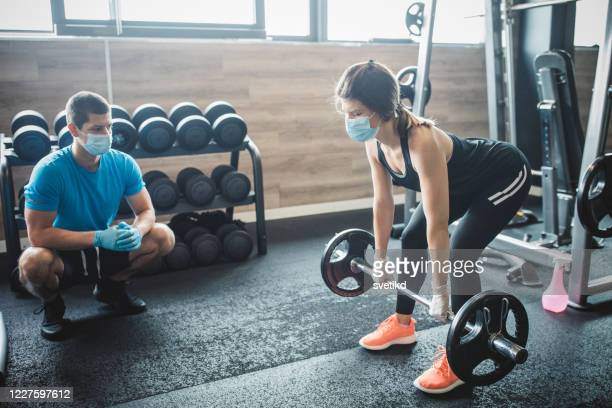 workout in gym after pandemic - coach stock pictures, royalty-free photos & images