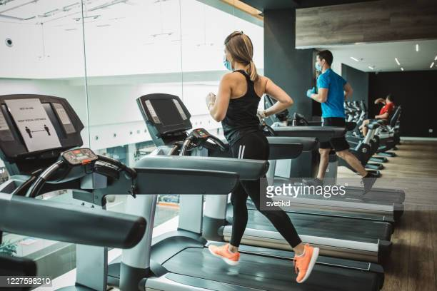 workout in gym after pandemic - reopening stock pictures, royalty-free photos & images