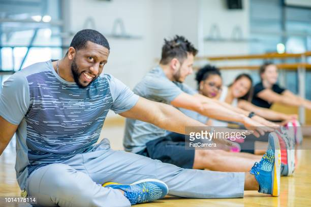 workout warmup - black male bodybuilders stock photos and pictures