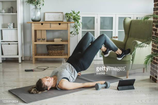 workout while in isolation - home workout stock pictures, royalty-free photos & images