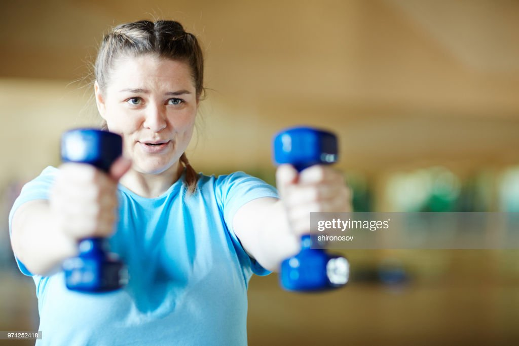 Workout with dumbbells : Stock Photo