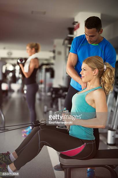 Workout with personal trainer in the health club.