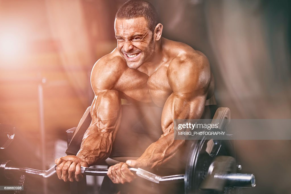 Workout with weights : Stock Photo
