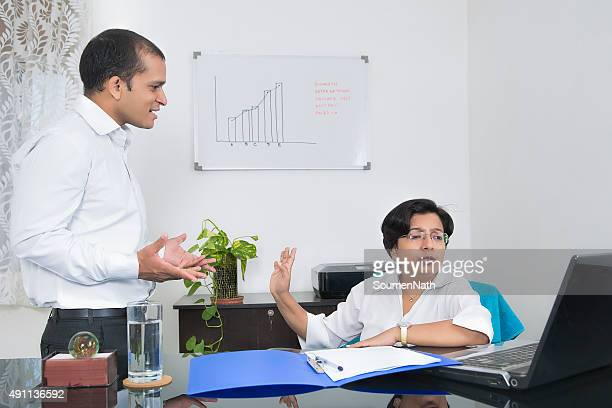 workplace conflict - bossy stock pictures, royalty-free photos & images