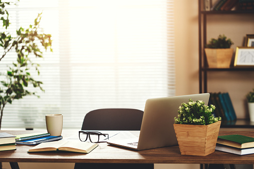 workplace   Desk with   computer at   window in   office at home in   apartment 1182529932