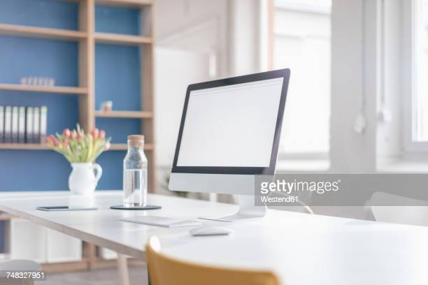 workplace in a loft - desktop pc stockfoto's en -beelden