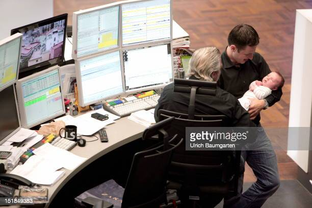 Workplace in the trading floor of the Deutsche Boerse Group Traders shows his colleagues newborn on August 28 2012 inFrankfurt am Main Germany