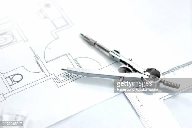 workplace of architect. architectural plan, compass drawing tool, engineering tools - drawing compass stock pictures, royalty-free photos & images