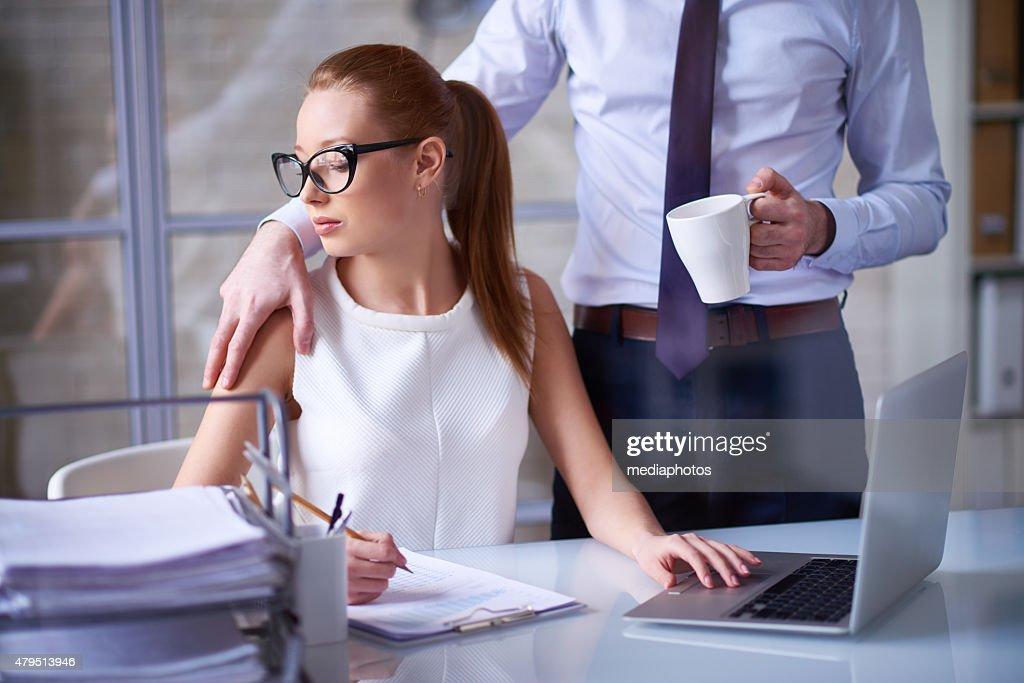 Molestie sessuali sul posto di lavoro : Foto stock