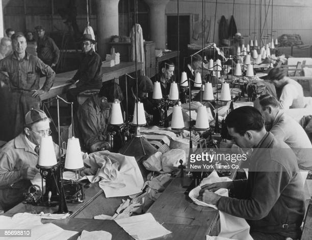Workroom at the a Federal Transient Service shelter for 500 unemployed men in Los Angeles, 12th December 1934. Residents receive food, clothing and...