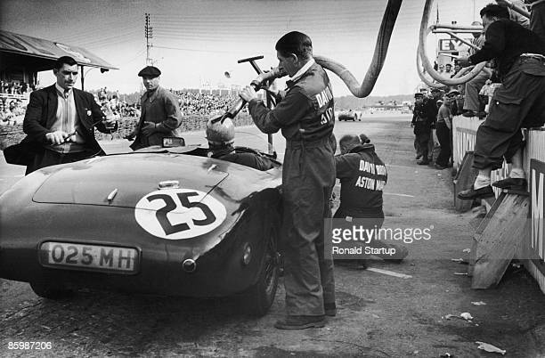 Works Aston Martin DB3 Spyder is refueled in the pits during the 24 Hours of Le Mans, at the Circuit de la Sarthe, France, 14th-15th June 1952. The...