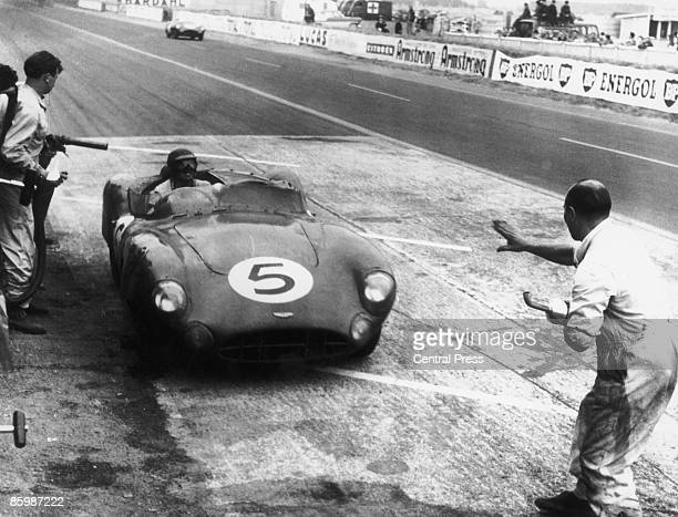A works Aston Martin DBR1/300 stops at the pits during the 24 Hours of Le Mans at the Circuit de la Sarthe France 20th21st June 1959 The car driven...