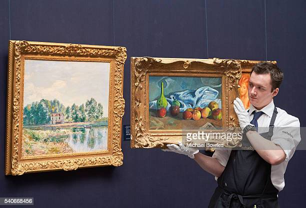 Works by Alfred Sisley and Paul Gauguin unveiled at Sotheby's on June 16 2016 in London England Alfred Sisley's Bords du Loing 1892 and Paul...