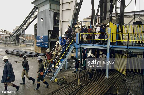 Works leave after a shift at Kinross, a small gold mining town in Mpumalanga, South Africa with four gold mines in the region.