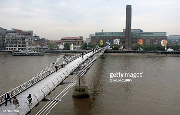 Works of art are pictured behind the Millennium Bridge on the river facade of the Tate Modern in London on May 23 2008 The Tate Modern commissioned...