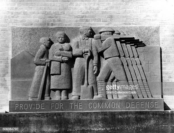 Works Projects Administration basreliefs of soldiers with text reading Provide for the Common Defense at Greenbelt school Maryland 1937 From the New...