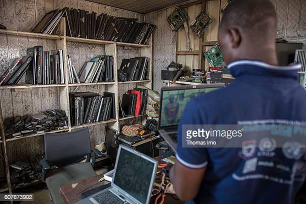 Workshop on the biggest electronic scrap yard in Agbogbloshie a district in Ghana's capital A young African dismantles old laptops on September 09...