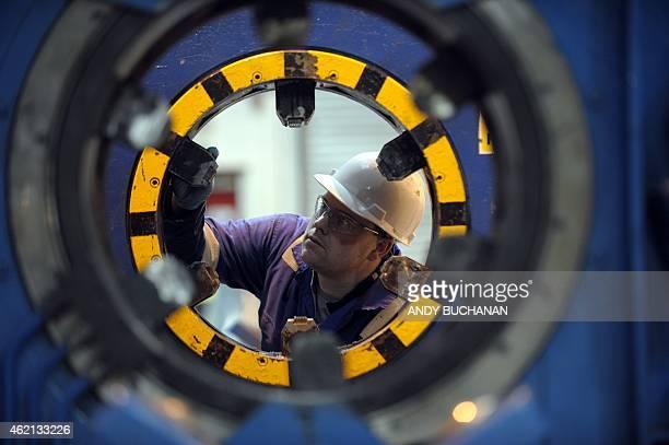 A workshop technician is seen working at Oilfield technology company Plexus in Aberdeen Scotland on January 21 2015 On the docks in Aberdeen oil...