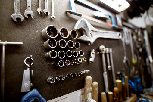 Workshop tool holder with a wrench and set of wrench sockets. 943560504