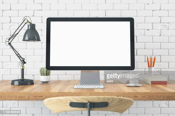workspace with blank computer screen - computer foto e immagini stock