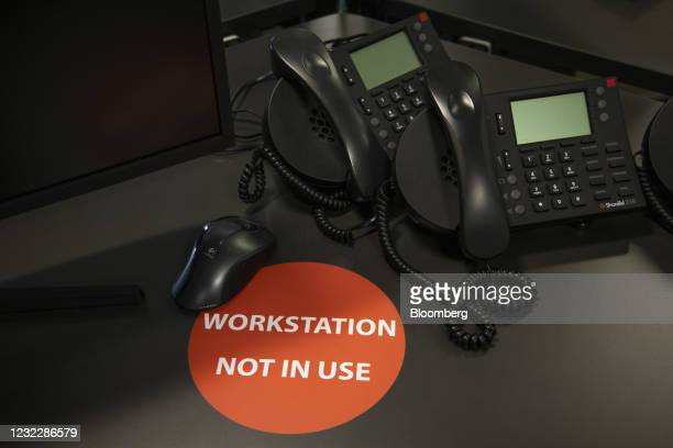 Workstation not in use sticker on a desk in the offices of N+1 Singer Ltd., during a tour showcasing coronavirus safety measures, in London, U.K., on...