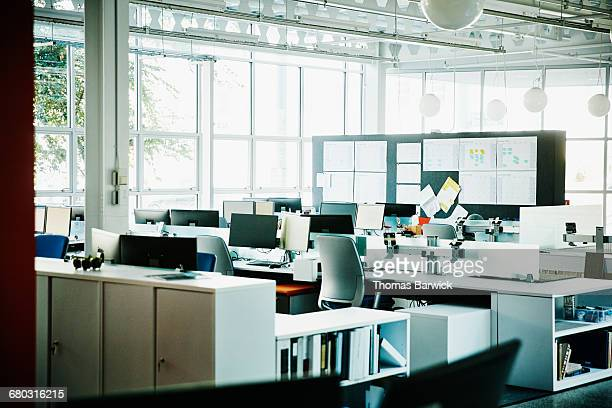 workstations in empty high tech office - no people stock pictures, royalty-free photos & images
